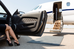 Rich and famous woman getting on her plane.